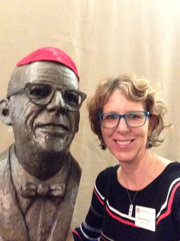 Lisa Petrillo takes a selfie with Dr. Keuper's bust.